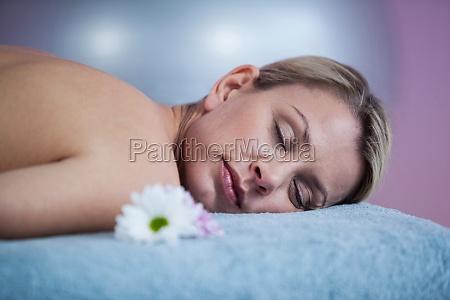 beautiful woman lying on a massage
