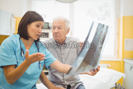 female doctor discussing x ray with
