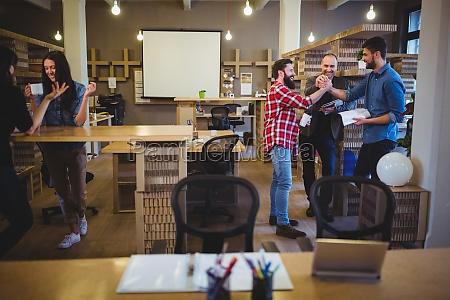 business people during coffee break in