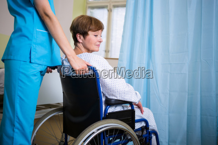 patient sitting on wheel chair with