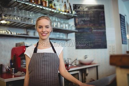 portrait of confident barista at coffee