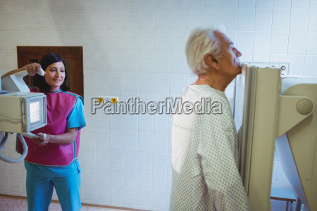 female doctor sets up the machine