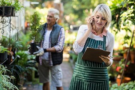 gardener talking on mobile phone while