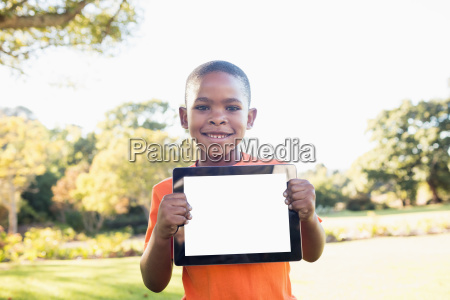 little boy showing a digital tablet