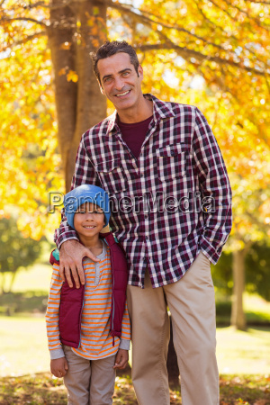 father with son at park during