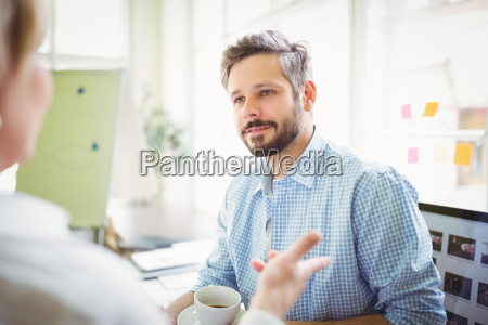 businessman discussing with colleague in creative
