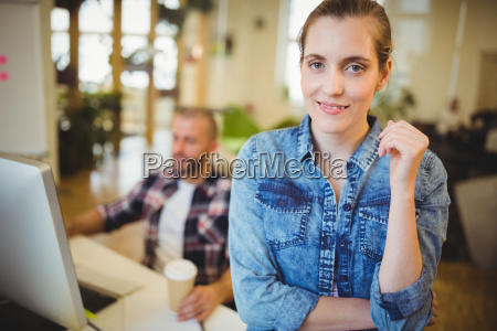 businesswoman with male colleague in office