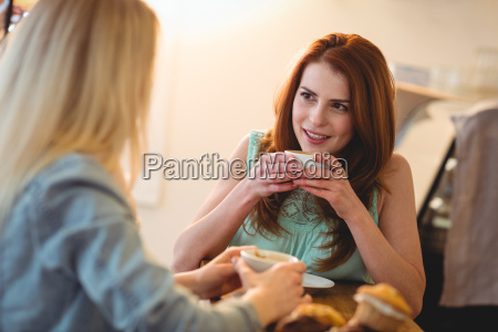 happy woman listening to friend at