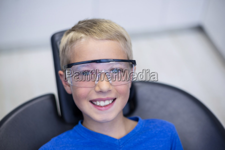 smiling young patient sitting on dentist