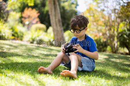 young boy checking a photograph in