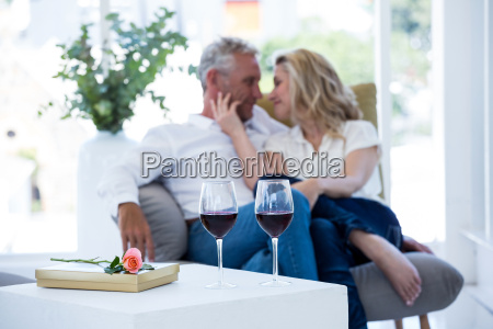 romantic couple sitting on armchair with