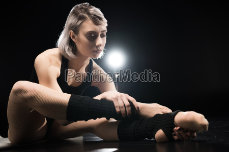 athletic young woman dancer in sportswear