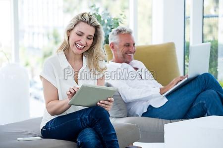 smiling mature couple using technology