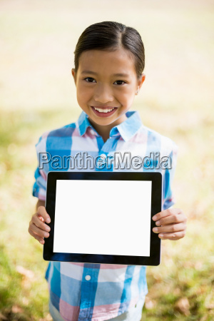 portrait of girl showing digital tablet