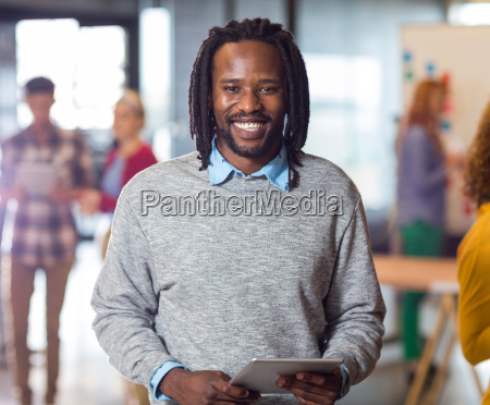 portrait of smiling man holding digital