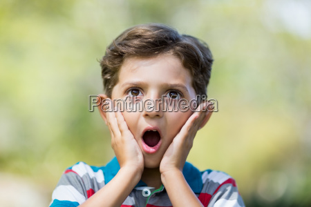 young boy making surprise expression while