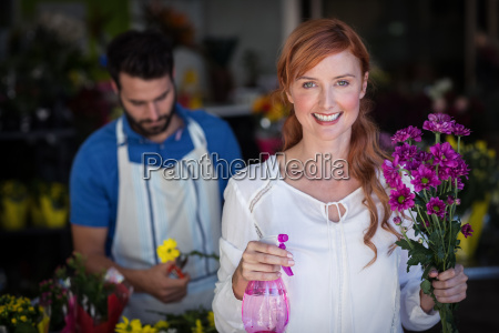 woman holding bunch of flowers while