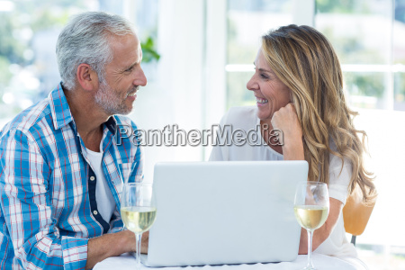 mature couple talking while sitting by