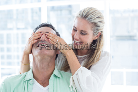 mid adult woman covering eyes of