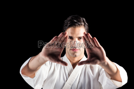 portrait of fighter performing karate stance