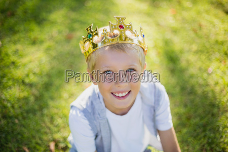 young boy wearing a crown and