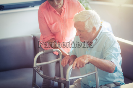 senior woman helping senior man to