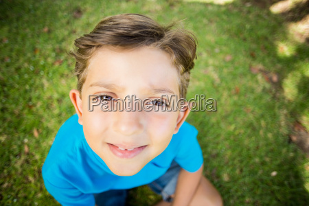 young boy smiling at camera in