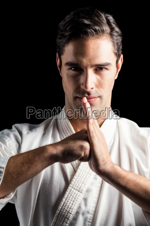 portrait of fighter performing hand salute