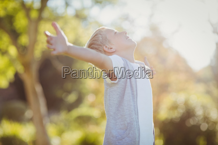 young boy with arms outstretched