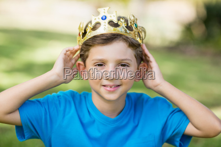 young boy wearing a crown in
