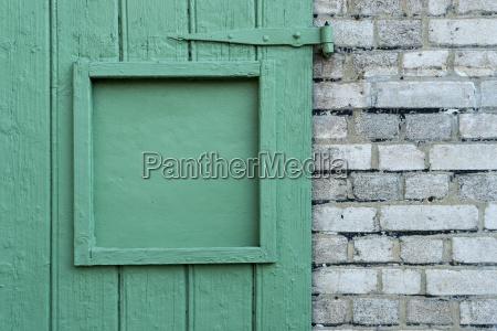 detail of a green wooden door