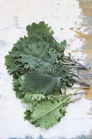 fresh kale leaves on a wooden