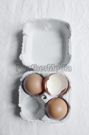 an egg box with whole eggs