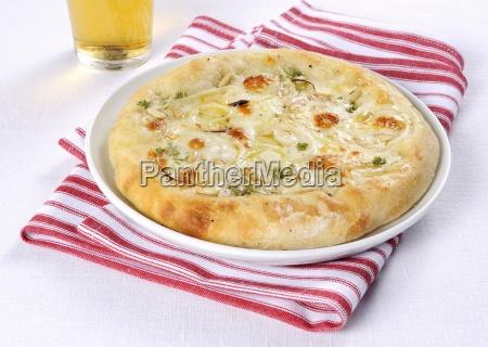 a small onion pizza with taleggio