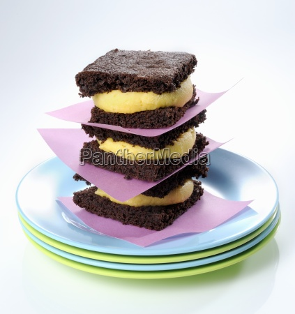 a stack of brownie sandwiches with