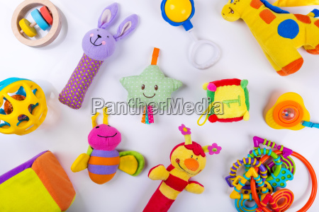 colorful baby toys on white top