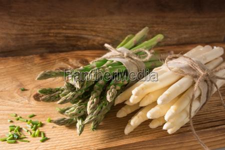 fresh asparagus on rustic wood