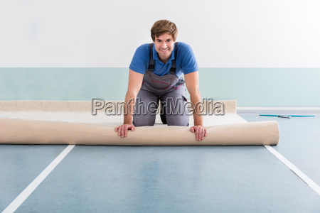 young man laying carpet