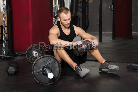 young man relaxing in the gym