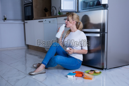 woman drinking milk in the kitchen