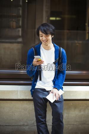 young japanese man enjoying a day