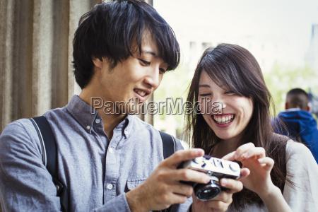 young japanese man and woman enjoying