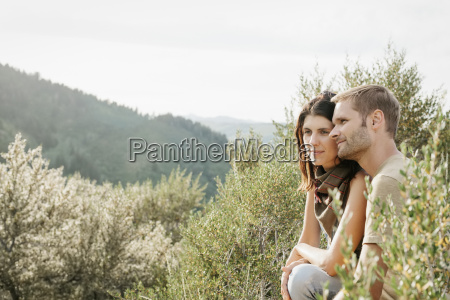 a couple in the mountains sitting