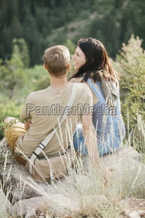 a couple in the mountains taking