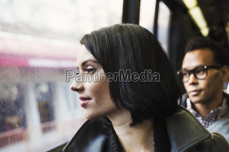 a woman sitting on public transport