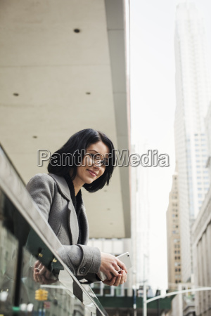 a young woman leaning over a