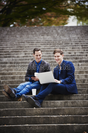 two young men sitting on a