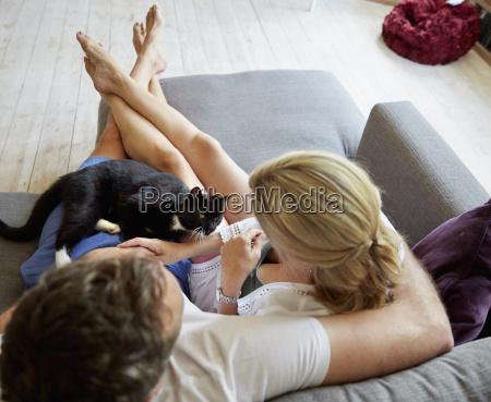a couple seated on a sofa