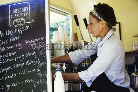 woman standing in a mobile coffee