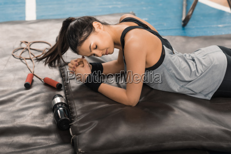 young sporty woman with closed eyes